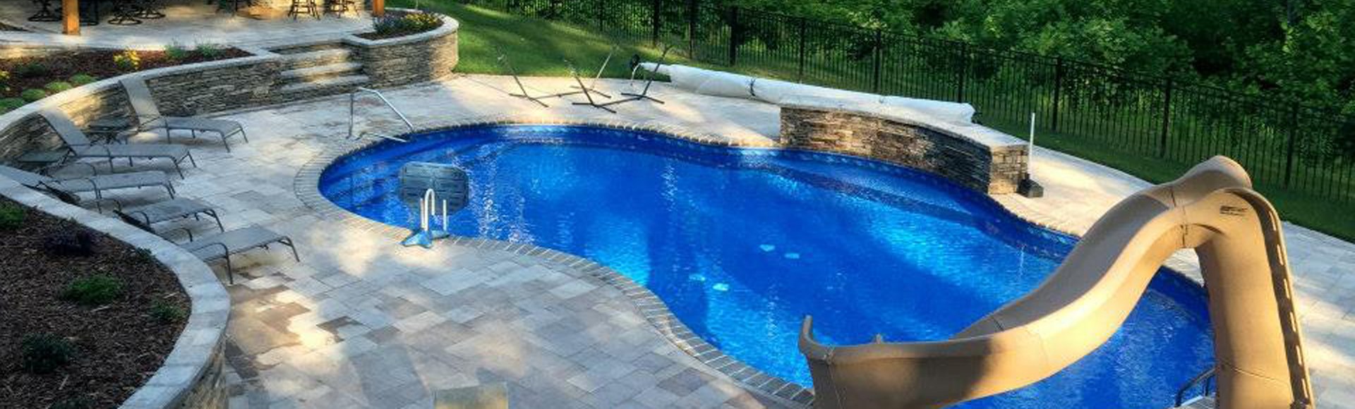 Inground custom pool design with slide