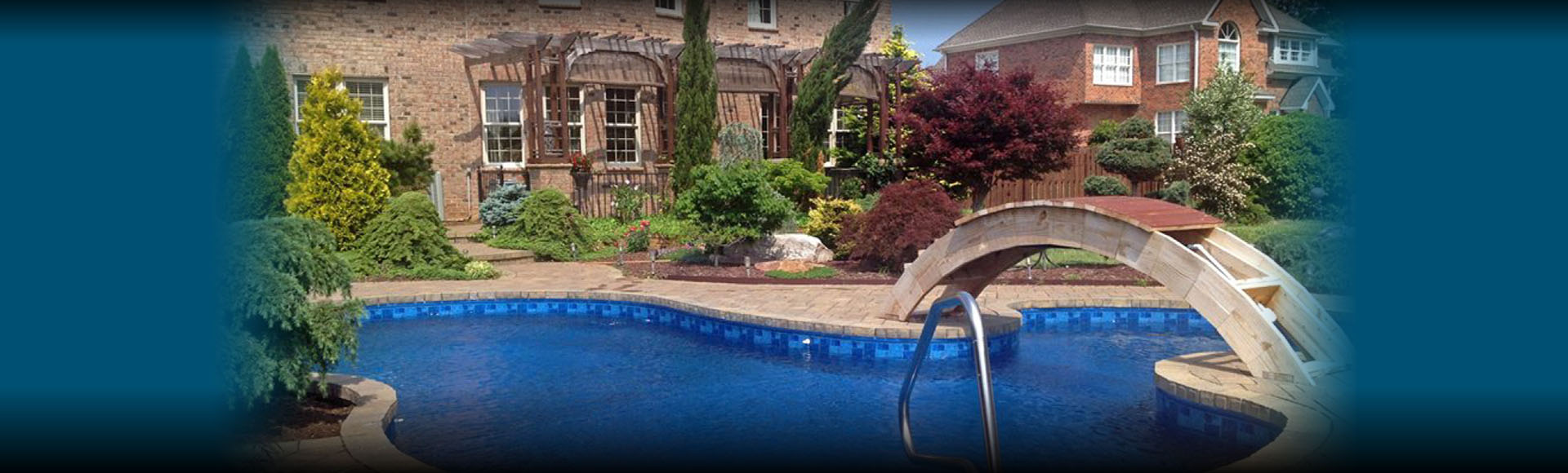 Custom Pool design with Bridge by Guilford Pools